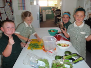 Making quiche and salad for lunch for the whole school