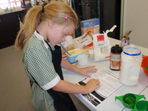 Reading the recipe for Anzac Biscuits